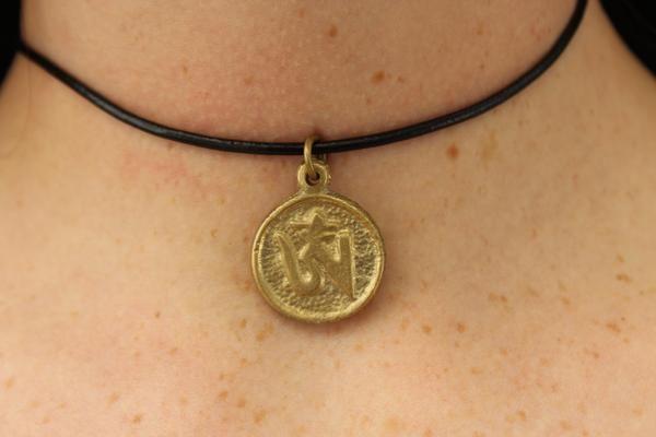 Brass round om pendant with black string $3.95 USD  #boho #gypsy #bohojewelry #hippiejewlery #gypsyjewelry
