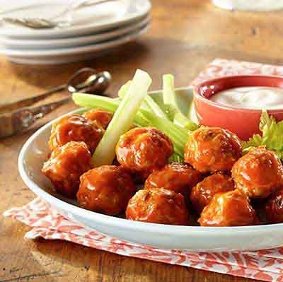 Spicy Buffalo chicken wings in meatball form - blue cheese included! These will be a favorite at your next party!
