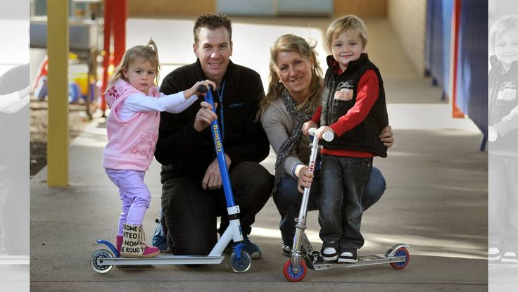 RIDING HIGH: Olivia Nunn, 2, Damien Cook, Cindy Francis and Eli Rochford, 4, at Horsham Supported Parents Playgroup. Damien Cook of Horsham Cyclery has donated two scooters for the playgroup. Picture: PAUL CARRACHER
