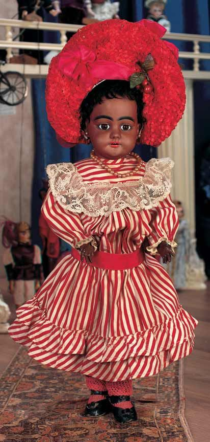 """Theriault's Antique Doll Auctions - Bisque Child,739,by Simon & Halbig with Brown Complexion - 18"""" -  S 11 H 739 dep. circa 1890. Rare model with beautiful flawless complexion, lovely painting, original wig, body, body finish, original costume including dress, red knit stockings, black leather shoes, red straw bonnet with silk ribbons."""
