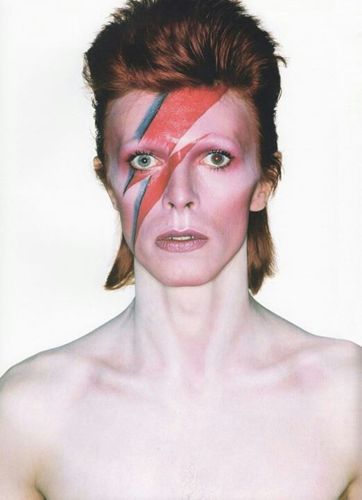 David Bowie would be a good choice if i where to use a male model. I like the idea of making his lightning bolt make up into the actual zombie wound.