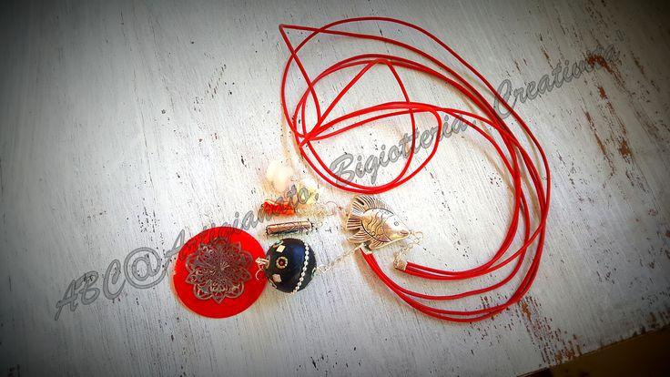 Collana in cordino di cauciu' colorato con pietre semipreziose