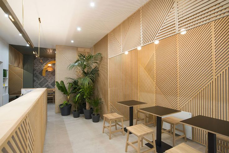 Wall Decor Idea - This restaurant covered its walls with wood panels that look like abstract line art