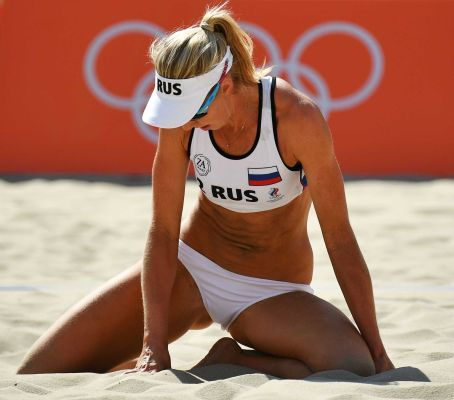 Russia's Evgenia Ukolova reacts during the women's beach volleyball qualifying match against Brazil at the Beach Volley Arena in Rio de Janeiro on Aug. 7, 2016, for the Rio 2016 Olympic Games.