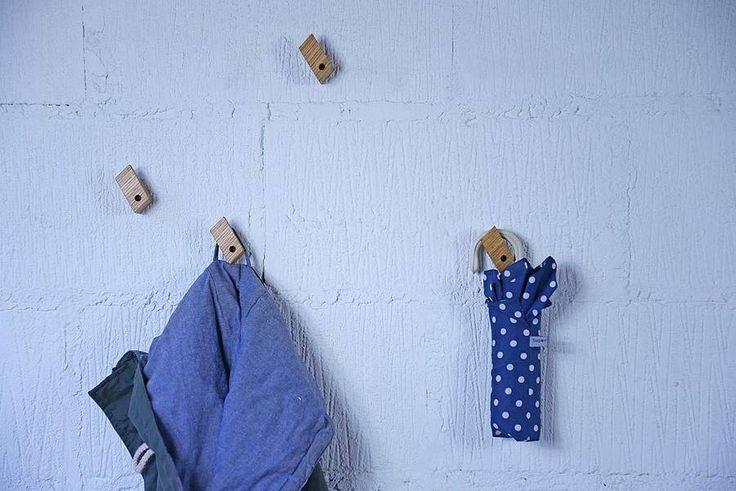 A Set Of Four Modern Coat Hooks