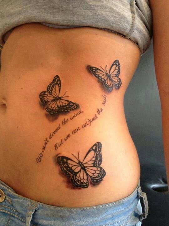 Butterfly tattoo. Love this...but only one butterfly and no words.