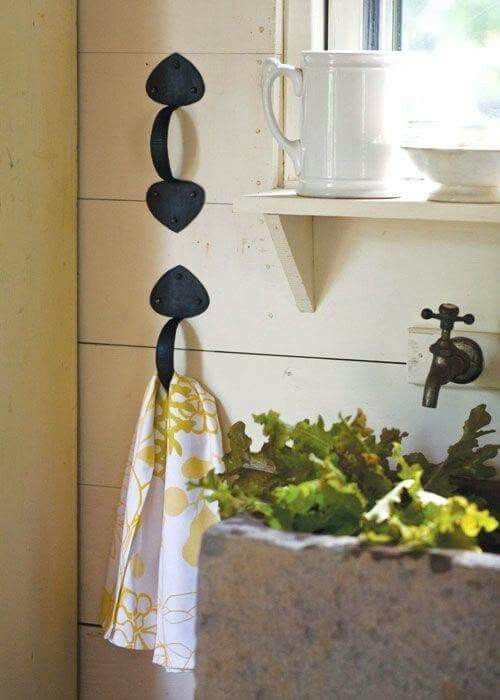 Hand Towel holder using vintage handles...love the window ledge and water spout