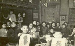 This is a photo of Japanese Canadian school children in a school in Lemon Creek, BC. It's credible because it was taken during the time period. Japanese Canadians had to fight for their education after being detained in 1942. But, they were allowed to teach children until they reached the 10th grade. The photo portrays what the school was like.