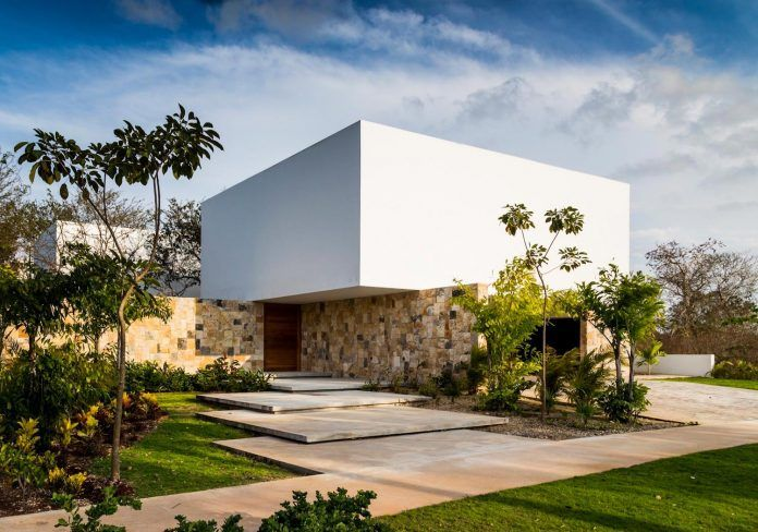 Irregularly shaped house surrounded by trees in an exclusive golf club development - CAANdesign | Architecture and home design blog