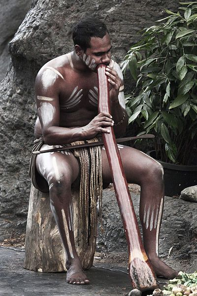 Australian Aboriginal playing the digeridoo.