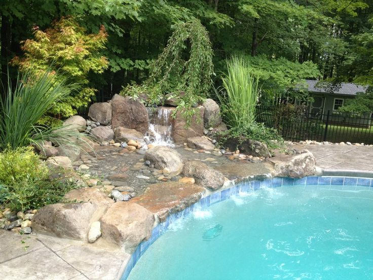 Custom Waterfall We Built. Natural Stone, Plantings And There You Go.