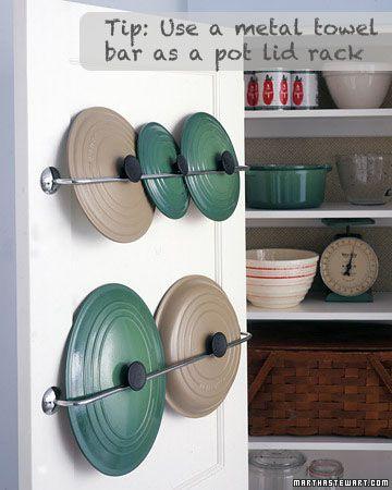 Turn a metal towel rack into pot lid rack.: Kitchens, Ideas, Towel Racks, Towels Racks, Towels Bar, Pot Lids, Lids Storage, Pots Lids, Cabinets Doors