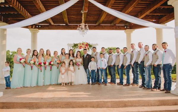 Looking to have a turquoise country wedding?  Love how gorgeous this bridal party is!  To see more photos from this real wedding, follow this pin to the blog! #turquoisebridalparty #countrybridalparty #turquoisewedding #southernwedding