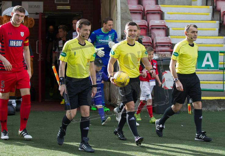 Referee Nick Walsh leads the teams out before the IRN-BRU Cup game between Dunfermline Athletic and Queen's Park.
