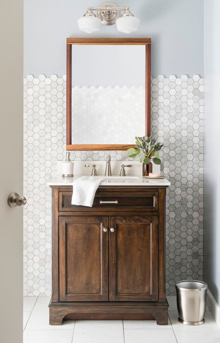 The Awesome Web Mahogany bathroom vanity with white quartz countertop brushed nickel faucet rectangular framed mirror schoolhouse light fixture marble mosaic wall tile