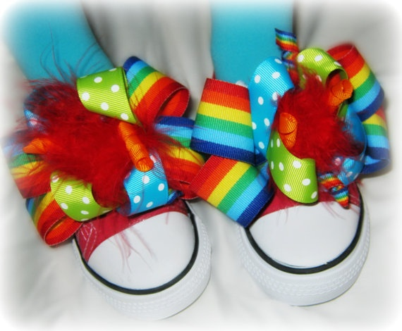 clown shoes--  Amy says--I don't like converse--no give, but I love the idea of taking normal shoes and decorating them with huge fun hair clips--that is what this looks like--