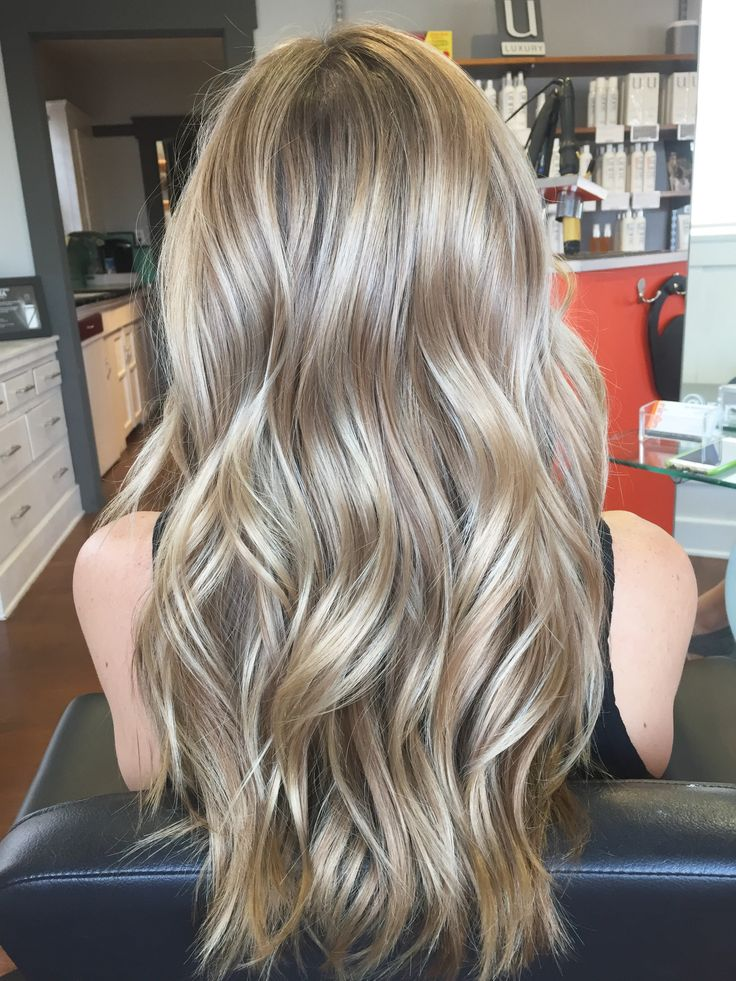 Balayage/Hair painted her to create a beautiful cool blonde and styled her with beachy waves❄️