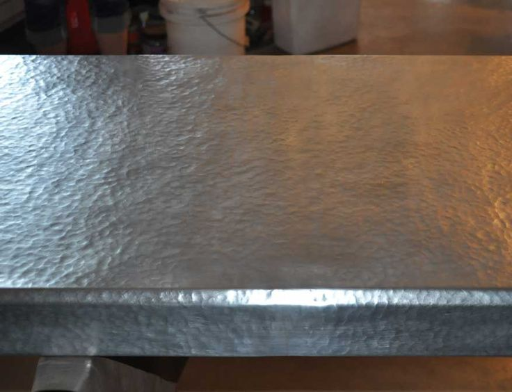 Hammered zinc countertop- Custom crafted using raw zinc hand hammered with beveled edge and rounded corners. Crafted in USA by local Montana Artist.