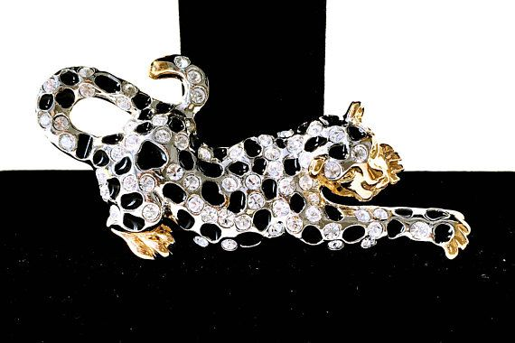 See new listings daily - follow us for updates.  Christmas in July Sale Rhinestone #Leopard Brooch, Signed #ROMAN, Rose Gold Tone Leopard Pin, #Vintage Leopard Brooch, Figural Leopard, Figural, Cat, Leopard, Wild Cat, Leopar... #vintage #jewelry #teamlove #etsyretwt #bestofetsy #leopard #mimisjewelryboutique #cat #figural #roman ➡️ http://jto.li/tB4wv