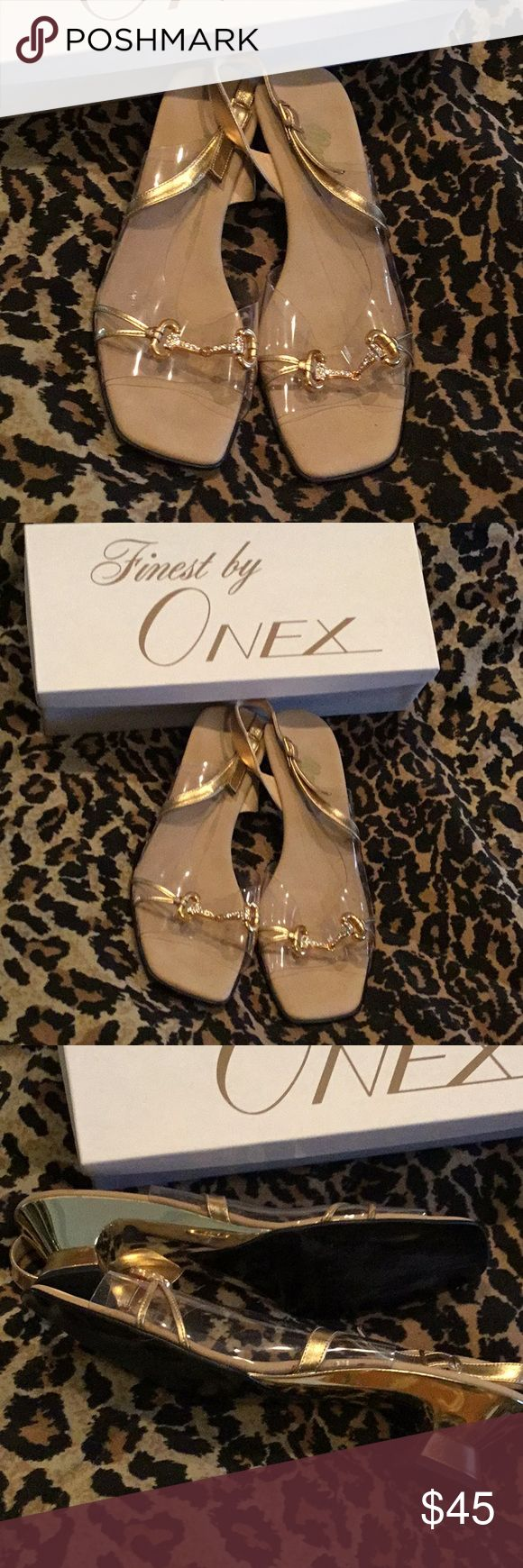 Onex Gold Metallic & Crystal Horsebit Sandal Absolutely fabulous Onex sandals with gold metallic heels that are leather at bottom, leather straps, the signature Onex Lucite with gold horsebit with crystal buckle, insole is leather and padded.  If you have worn Onex, you know that they're the most comfortable shoes ever, worn about three times and in excellent condition.  These shoes are a size 10, but run very small and will fit a size 9 perfectly. Onex Shoes Sandals