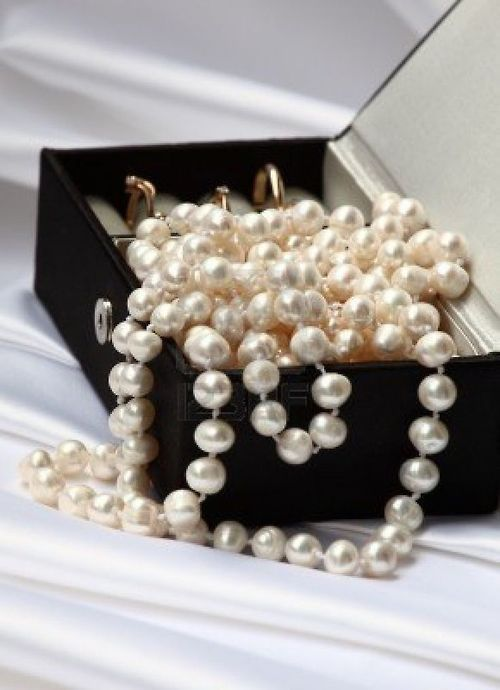 picture of pearls and gold rings in black jewelry box on neutral background stock photo images and stock photography