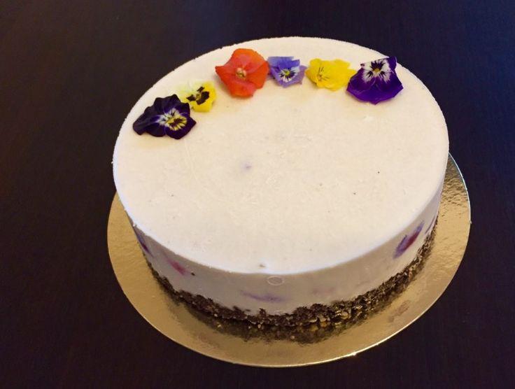 Raw vegan cake with coconut cream and strawberry
