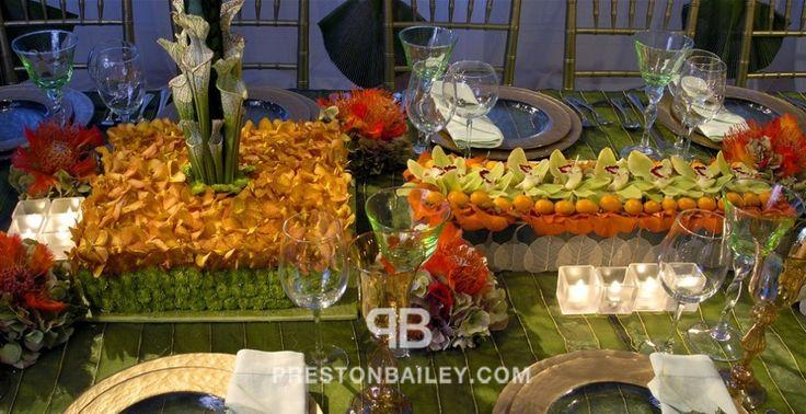 candles centerpiece hydrangeas leaves long table low centerpieces moss mum oranges orchid pin cushion flower pitcher plant table setting color|green color|orange