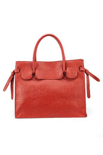 The shoulder bag crafted in PU, featuring elegant retro feel with notched upper panel, unique adjustable lace-up sides and double shoulder straps fastening to the sides.