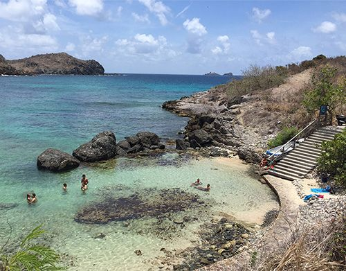 Shallow waters for sunning at La Petite Anse.