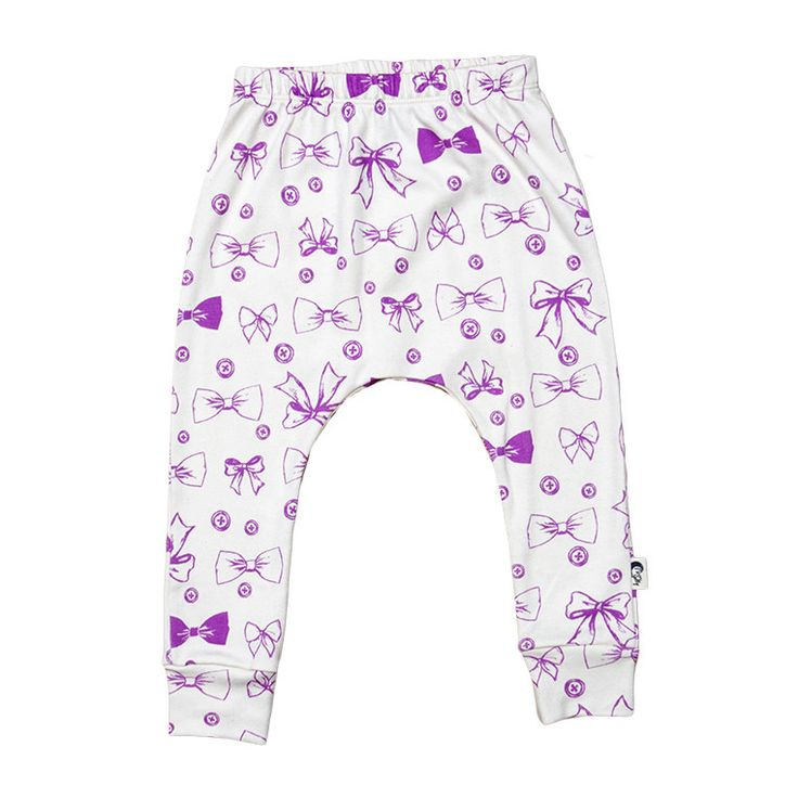 Slim Harem Full Length Pant - Buttons & Bows Printed super soft and stretchy 100% Organic Cotton slim harem full length pants. The shape and stretch makes them comfortable to wear for both sleep and play. Match them with one of our printed T-shirts  Hand Illustrated Buttons & Bows are printed onto our natural organic cotton in rosebud.