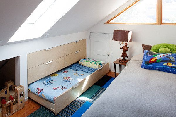"not a bunk bed but a great idea: A sly pull-out sleeping drawer provides room for a guest. ""When I built this house, I wanted to be sure that there was room for my sister's kids,"" Duvivier said."