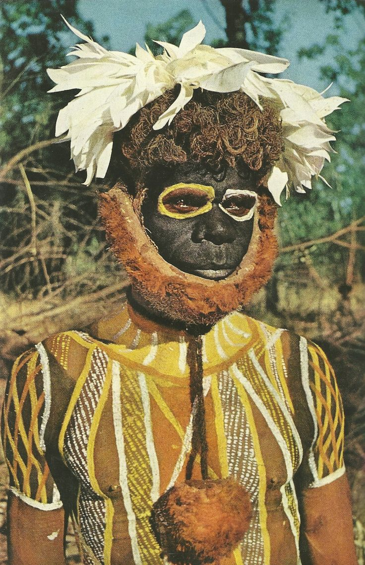 Australia | For his late uncle a Tiwi tribesman wears a false beard and paint at a corroboree to prevent the dead man's spirit from recognizing and harming him.  Melville Island | ©Charles P Mountford; National Geographic, March 1956.