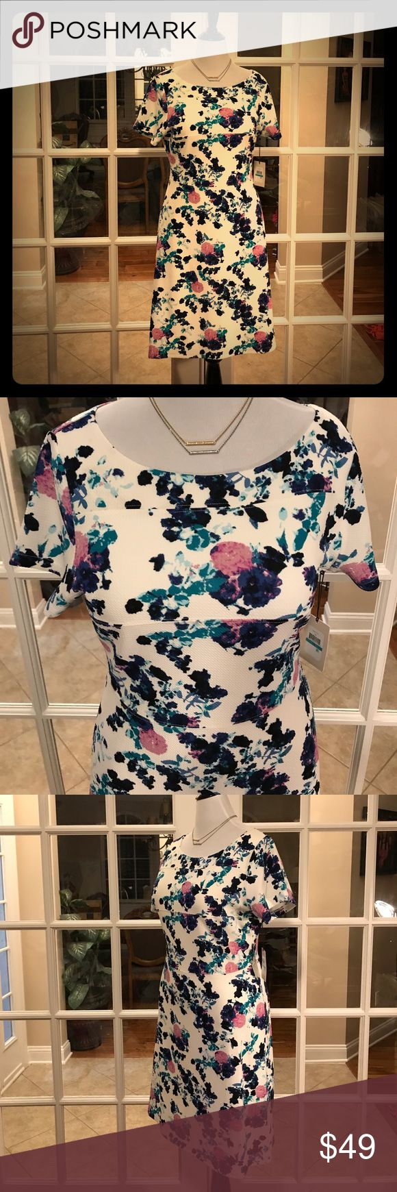 🆕 Ivanka Trump Spring/Summer Midi Dress This Ivanka Trump Spring/Summer Midi Dress is so pretty and super comfortable.  The body is fully lined and has great stretch!   Shell is 92% Polyester, 8% Spandex.  Lining is 100% Polyester.  💕 Ivanka Trump Dresses Midi