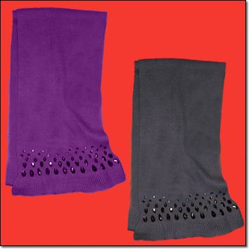 """Jeweled Scarf* Faux-stone accents. 78"""" L x 9 1/2"""" W. 2"""" ruffled trim. Acrylic. Hand wash and dry. Imported. Purple, Grey Brochure + Gift Guide: $14.99 each"""