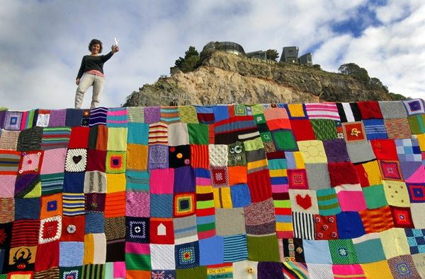 A container used as protection from falling hill and rocks in the suburb of Sumner has been yarn-bombed by knitters and crocheters.
