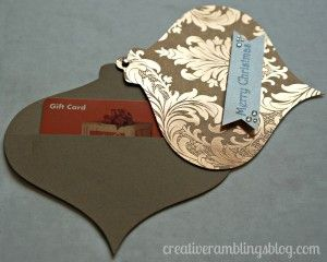 Gift card holder / card in the shape of a Christmas ornament  - swivels to reveal gift card -- what a great idea!  via creativeramblingsblog.com