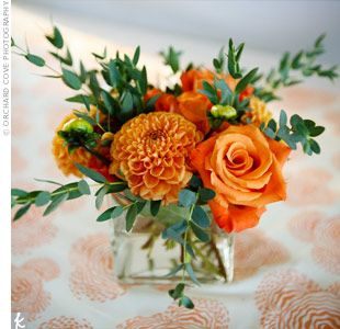 Orange Centerpieces with greenery