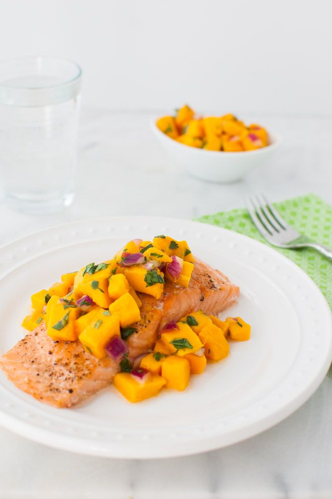 Roasted salmon with mango salsa - easy weeknight dinner especially in the summer when mangos are in season. Substitute your favorite fish if you don't like salmon.