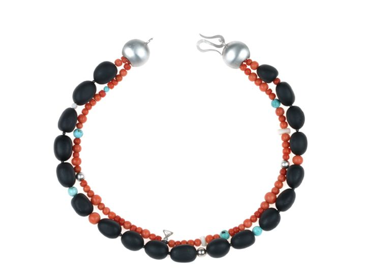 The inheritance of Emma, the story. Emma inherited a beautiful triangular diamond and a necklace of red coral beads from her Grandma. Handcrafted. Costum made order by Marion Pannekoek | The Jewelry Story