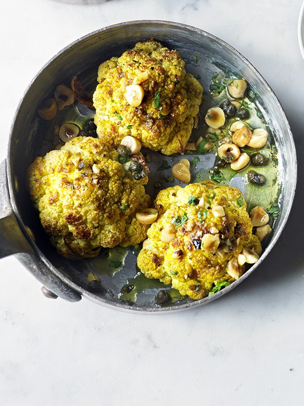 Spiced baked cauliflower with caper raita - You need small caulis the size of your fist for this – it's quite rich so don't be tempted to use huge ones. They'll go well with the Christmas veg, so will make a good Christmas day main for any non-meat eaters