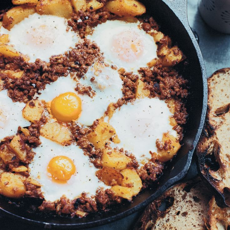 Thanksgiving Day Breakfast These baked eggs with chorizo—a hearty combination of crumbled spicy sausage, chunks of crispy potatoes and soft, runny eggs—are great to make for a crowd.