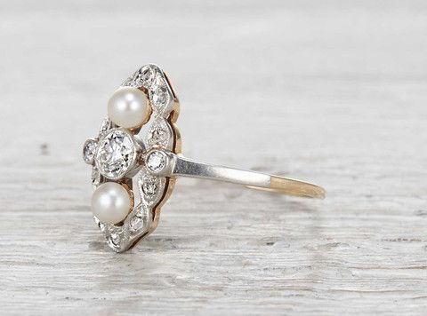 Vintage Edwardian navette ring made in 18k yellow gold and platinum. Centered with a .30 carat old European cut diamond. Accented with two pearls and single cut diamonds. Circa 1905.