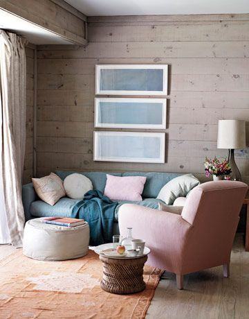 "Love this colour-scheme..  The pink-and-blue living room's washed wood walls give it a beachy feel. ""We kept all the fabrics to natural, muted tones, and it's all of the colors you see in the views — whites, grays, blues, a bit of pale pink,"""