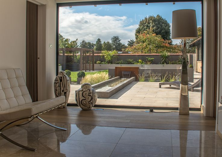inside out garden with cor ten steel water feature and rill