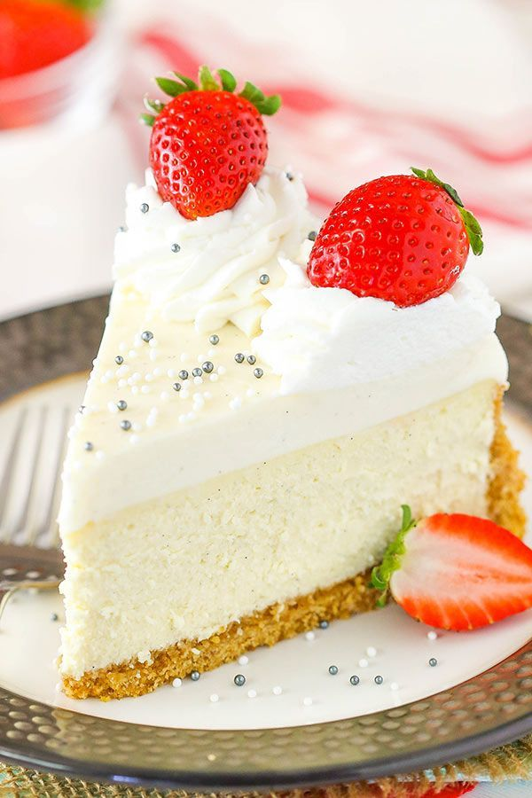"""This Vanilla Bean Cheesecake is a classic! A graham cracker crust is filled with a smooth, thick and creamy vanilla bean cheesecake topped with vanilla bean mousse! So yesterday, I totally earned the """"Aunt of the Year"""" award. My brother and sister-in-law were at the Atlanta Falcons game (they are fans – booooo!  ), …"""
