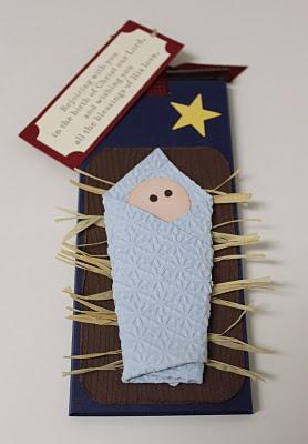 niño jesús con una servilleta de papel