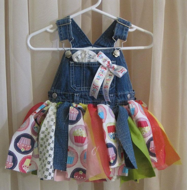 Denim tutu dress made from recycled bib overall jeans. The tutu part can be made from tulle or fabric. Vintage fabric is used when available. A removable Happy Birthday ribbon is included.  $32.
