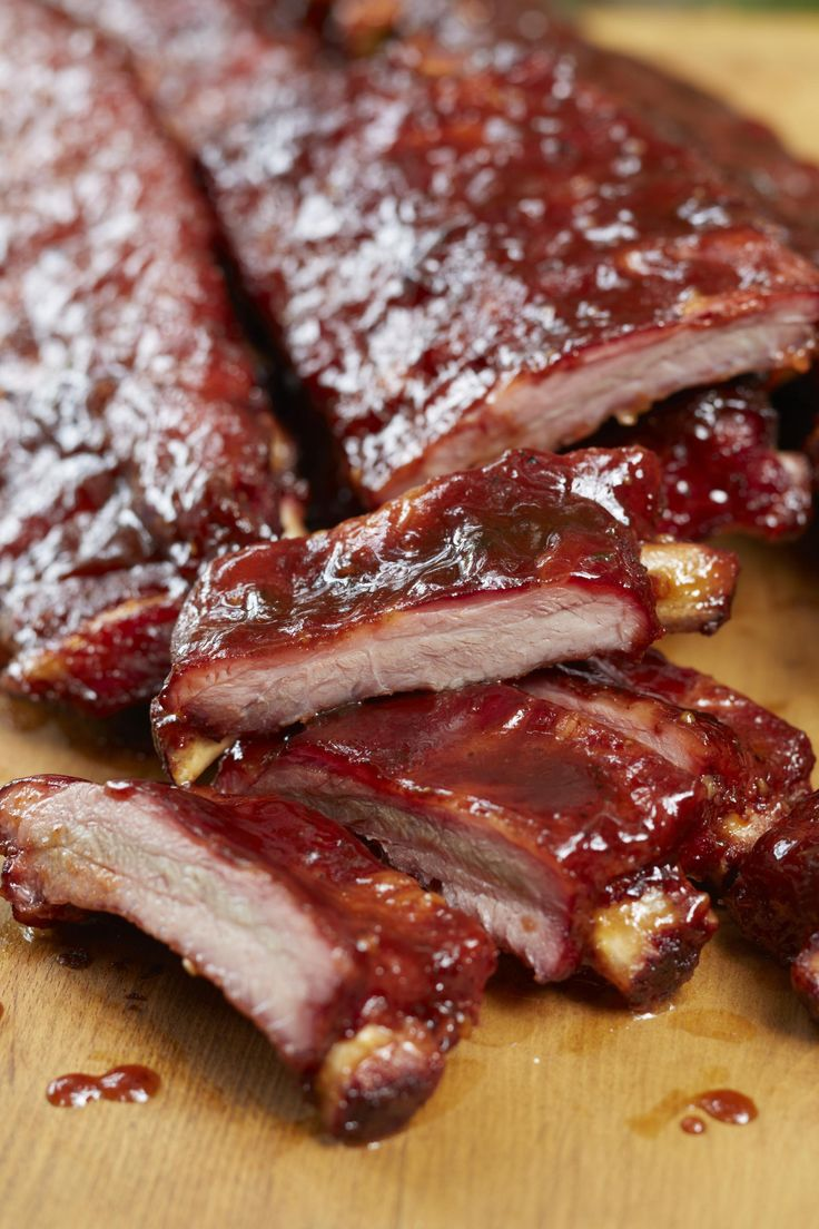 RECIPE: TENDER BBQ PINEAPPLE PORK RIBS - 2 racks St Louis pork ribs. 2 Tbs sesame oil, 4 tsp soy sauce, 1/2 C pineapple juice, 1 Tbs red pepper flake, 1/4 tsp ginger & garlic powder, 1/2 C brown sugar, 1 tsp onion flake, 1/4 tsp onion powder. Bake in oven, meat side up, at 250 degrees F for 2 1/2 hours. Place meat side up on a medium (250°F) charcoal grill for 1 hr. for smokey flavor. Finally anoint meat for 15 minutes, flipping & glazing with sauce. Let rest 10 minutes. Serves 6-8.