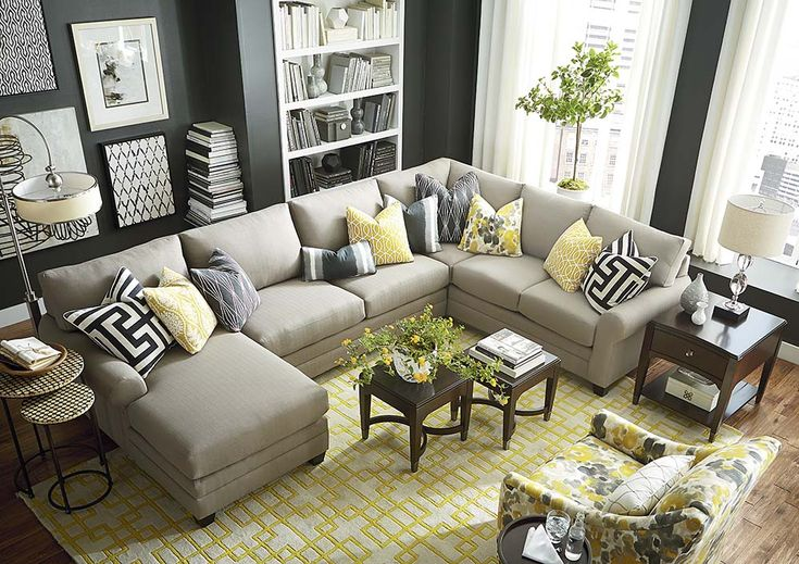 Moderately scaled Upholstery collection that features a sock arm, loose box back, top stitched seat cushion and tapered legs available in a choice of fi...