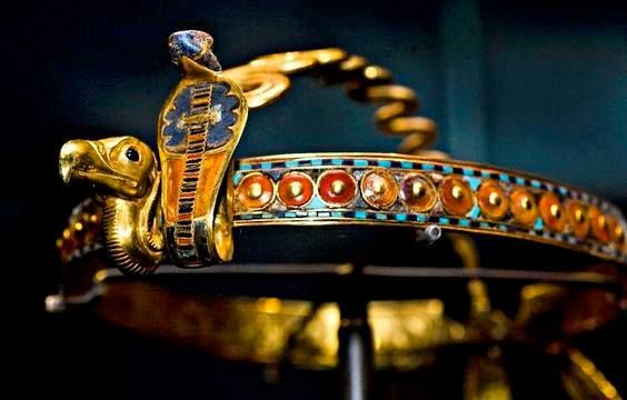 Diadem of Tutankhamun Inlaid Diadem with Vulture and Cobra - Gold, glass, obsidian, carnelian, malachite, chalcedony, lapis lazuli.  Dynasty 18, reign of Tutankhamun (1332–1323 B.C.)  Thebes, Valley of the Kings, tomb of Tutankhamun Studded with semiprecious stones, this crown was found on the head of King Tutankhamun's mummified body and was probably worn by the pharaoh in life.